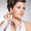 Young and beautiful bride preparing for the wedding — Stock Photo