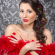 Cabaret artist in red boa over the vintage background — Stock Photo