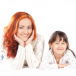 A happy mother and a young daughter on a light background — Stock Photo #27027687