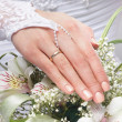 Stock Photo: Fresh and beautiful wedding bouquet in bride's hands
