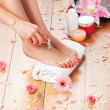 Spa background with a beautiful legs. — Stock Photo