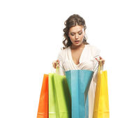 Young attractive girl with the shopping bags isolated on white — Stock Photo