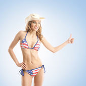 Young, slim, healthy and beautiful woman in swimsuit — Stock Photo