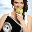 Stock Photo: Portrait of young and healthy woman as dieting concept