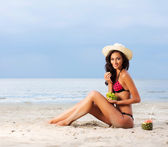 Beautiful and healthy young woman near the sea — Stock Photo