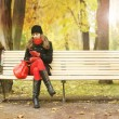 Young and beautiful woman in autumn park — Stock Photo