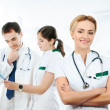 Team of young and smart medical workers over abstract hospital background — Stock Photo