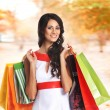 Young beautiful woman with some shopping bags isolated on white — Стоковое фото
