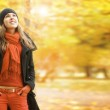 Young attractive girl in autumn park — Stock Photo #32184107