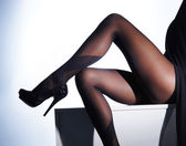 Photo of the beautiful legs in nice stockings — Stock Photo