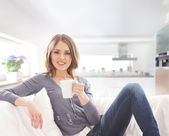 Young attractive woman with a cup of coffee — Stock Photo