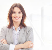 Young and attractive business woman working in office — Stock Photo