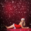 Young sexy Santa in lingerie over red background — Stock Photo #35958109