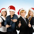 Foto Stock: Young attractive business people in Christmas style