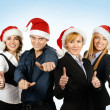 Stock Photo: Young attractive business people in Christmas style