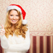 Beautiful teenager girl in a Christmas hat — Stock Photo