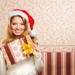 Stock Photo: Beautiful teenager girl with present
