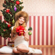 Beautiful teenager girl and the Christmas tree — Foto de Stock