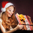 Foto de Stock  : Young teenage girl opening the present