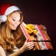 Young teenage girl opening the present — ストック写真