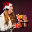 Young teenage girl opening the present — Stock Photo