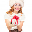 A happy woman posing in warm winter clothes — Stock Photo
