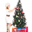 A happy woman decorating the Christmas tree on white — Stock Photo #35959925