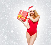 A young and sexy woman posing in red Christmas lingerie — Stock Photo