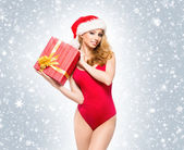 A young and sexy woman posing in red Christms lingerie — Stock Photo