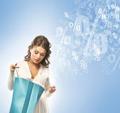 Beautiful woman with the bright shopping bags ovr the blue backg — Stock Photo