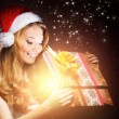 Young teenage girl opening the present — Stock Photo #35960073