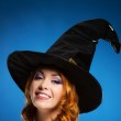 Portrait of a happy woman in a black witch hat — Stock Photo #35960029