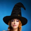 Portrait of a happy woman in a black witch hat — Stock Photo #35960031