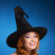 Portrait of a happy woman in a black witch hat — Stock Photo