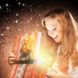 A happy teenage girl opening a Christmas present — Stock Photo #35960067