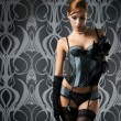 A young redhead woman posing in luxurious lingerie — Stock Photo #35960407