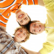 Stock Photo: Three happy teenage boys hanging out together