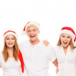 A group of happy and emotional teenagers in Christmas hats posin — Stock Photo