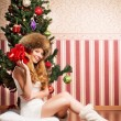 Beautiful teenager girl and the Christmas tree — Stock fotografie #36881595