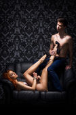 A young and sexy couple laying in erotic lingerie — Stock Photo
