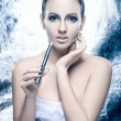 Stock Photo: Fashion shoot of young womsmoking electronic cigarette