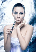 Fashion shoot of a young woman smoking an electronic cigarette — Stock Photo