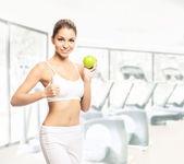 A young and fit woman working out with dumbbells — Stock Photo