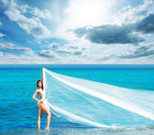 Woman on summer beach — Stock Photo