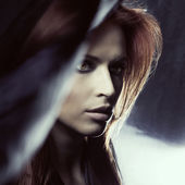 Attractive woman in darkness — Stock Photo