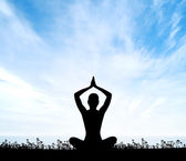 Silhouette of a woman doing yoga exercise — Stock Photo
