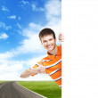 Teenage boy with a blank banner — Stock Photo #45263281