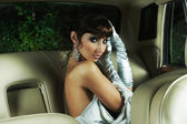 Superstar girl sitting in a retro car — Stock Photo