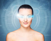 Woman with the virtual hologram on her eyes — Stock Photo