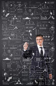 Businessman working with a plan — Stock Photo